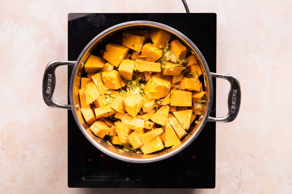 cubed pumpkin in saucepan for pumpkin soup