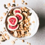 bowl of homemade almond granola topped with sliced figs