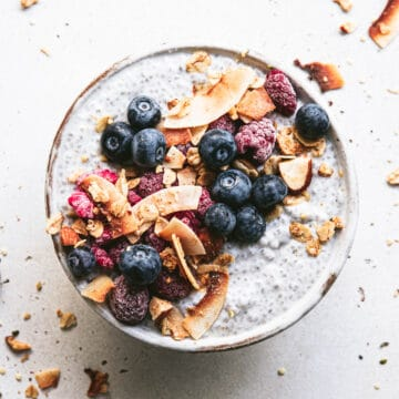 coconut chia pudding topped with berries and granola
