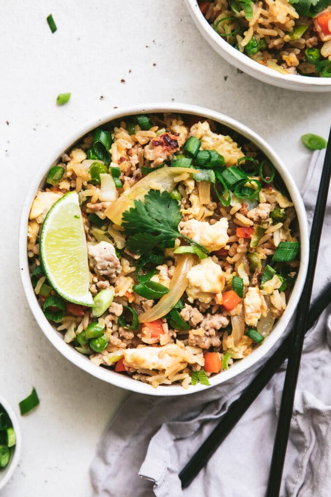 image of pork fried rice topped with lime coriander