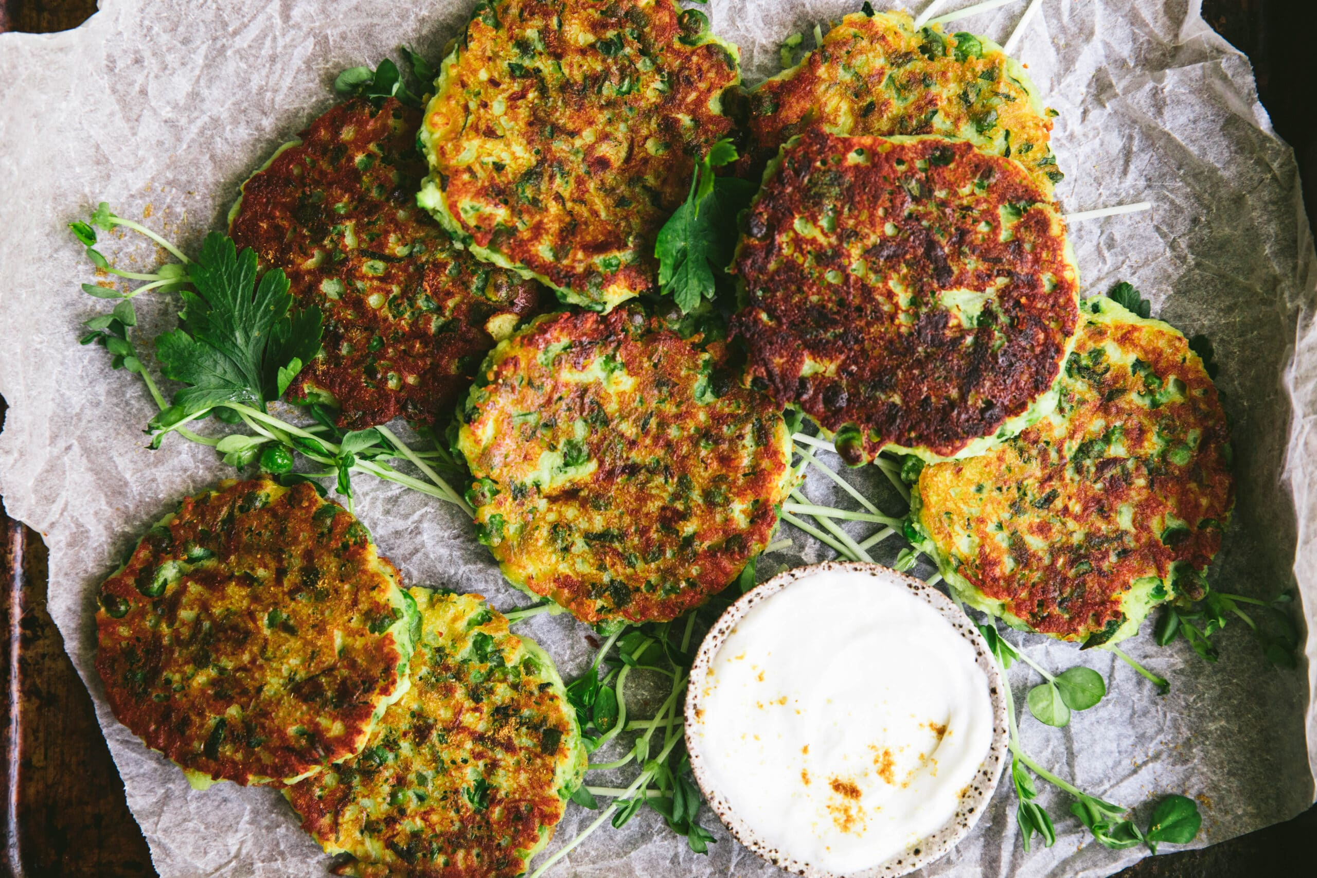 close up shot of zucchini and pea egg free fritter