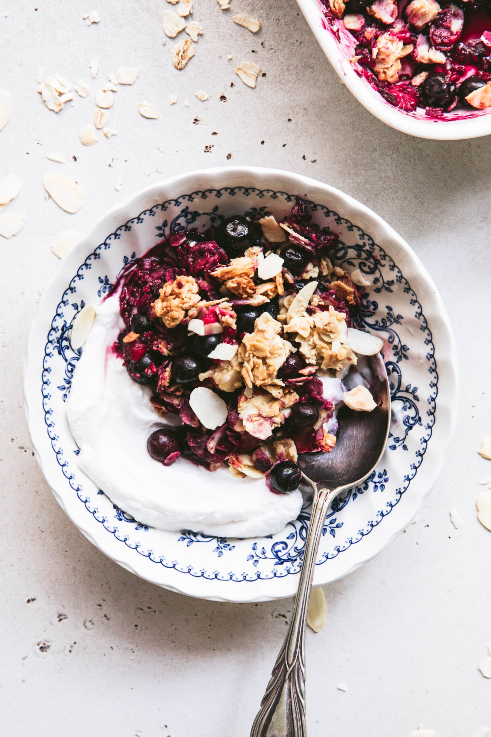 serve berry breakfast crumble with yoghurt for a healthy breakfast