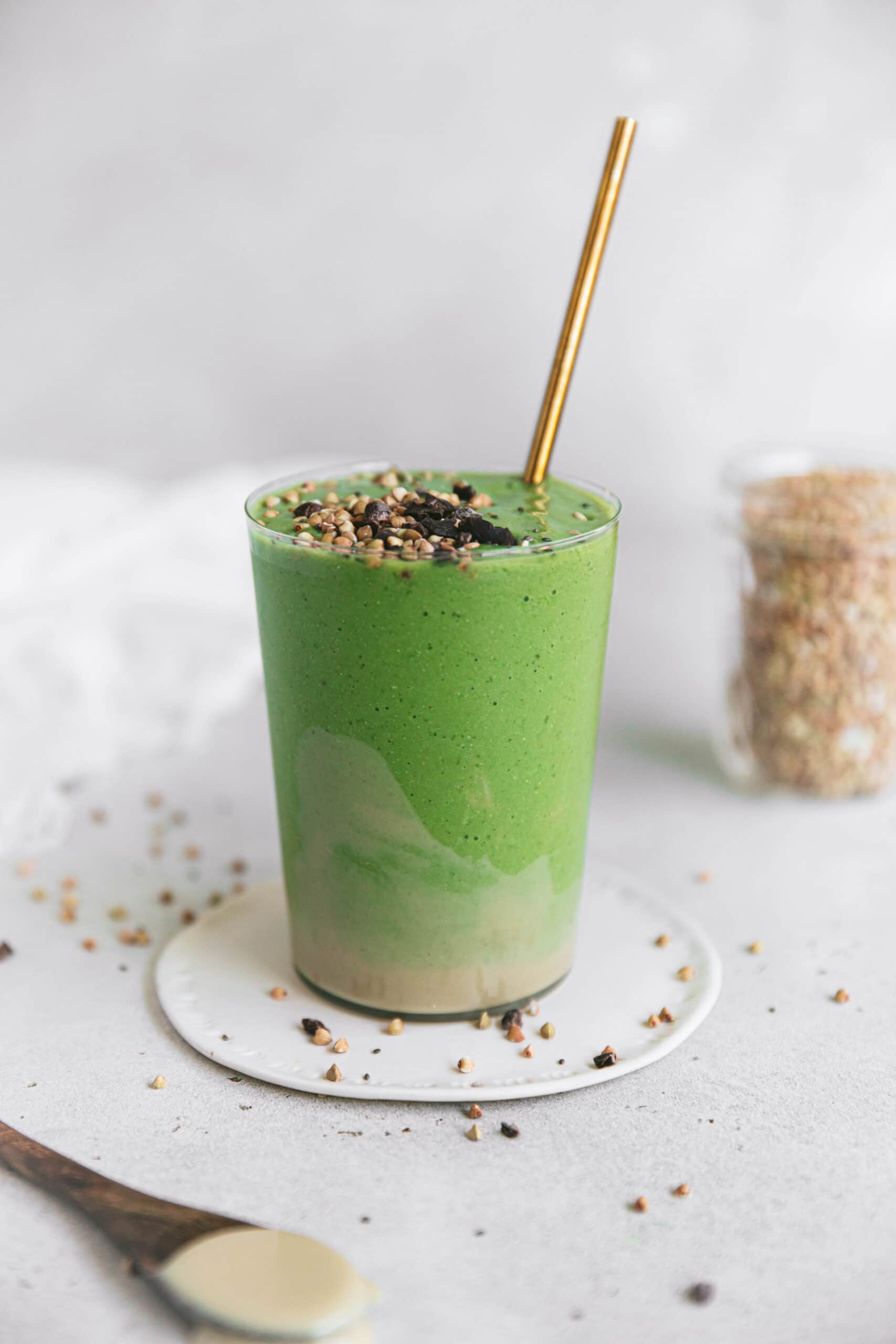 green smoothie in glass tumbler with tahini
