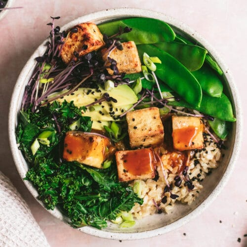 crispy tofu recipe with orange tamari sauce served with kale, brown rice and snow peas