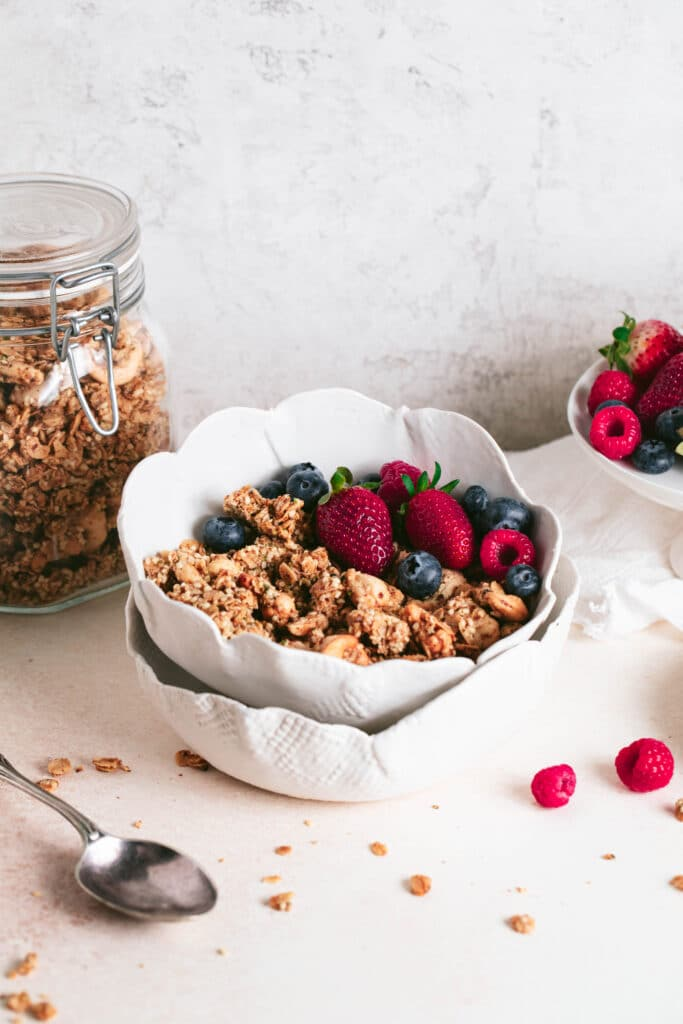 homemade granola in a bowl with berries