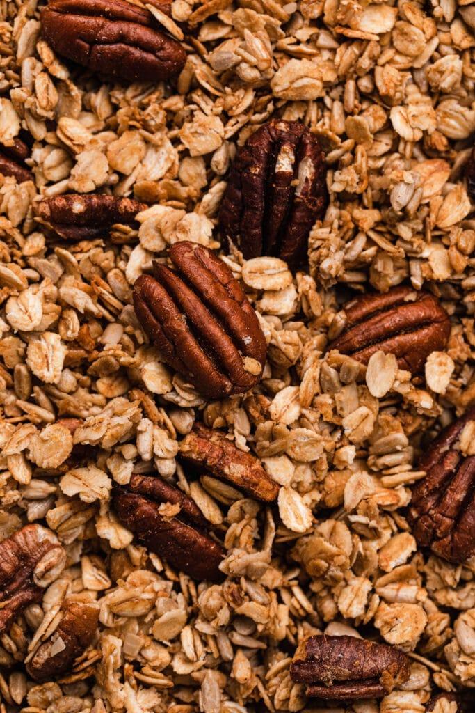 A close up shot of pecan, honey and ginger granola