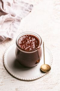 dairy free chocolate sauce in small jar