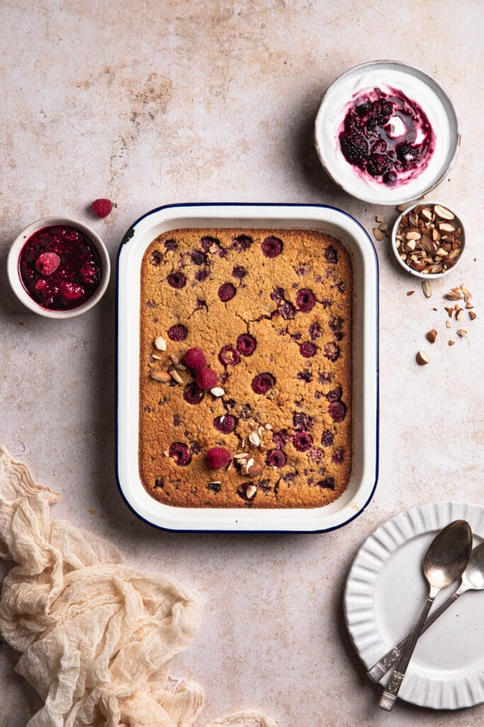 Baked Raspberry Oatmeal with yoghurt and berry coulee.