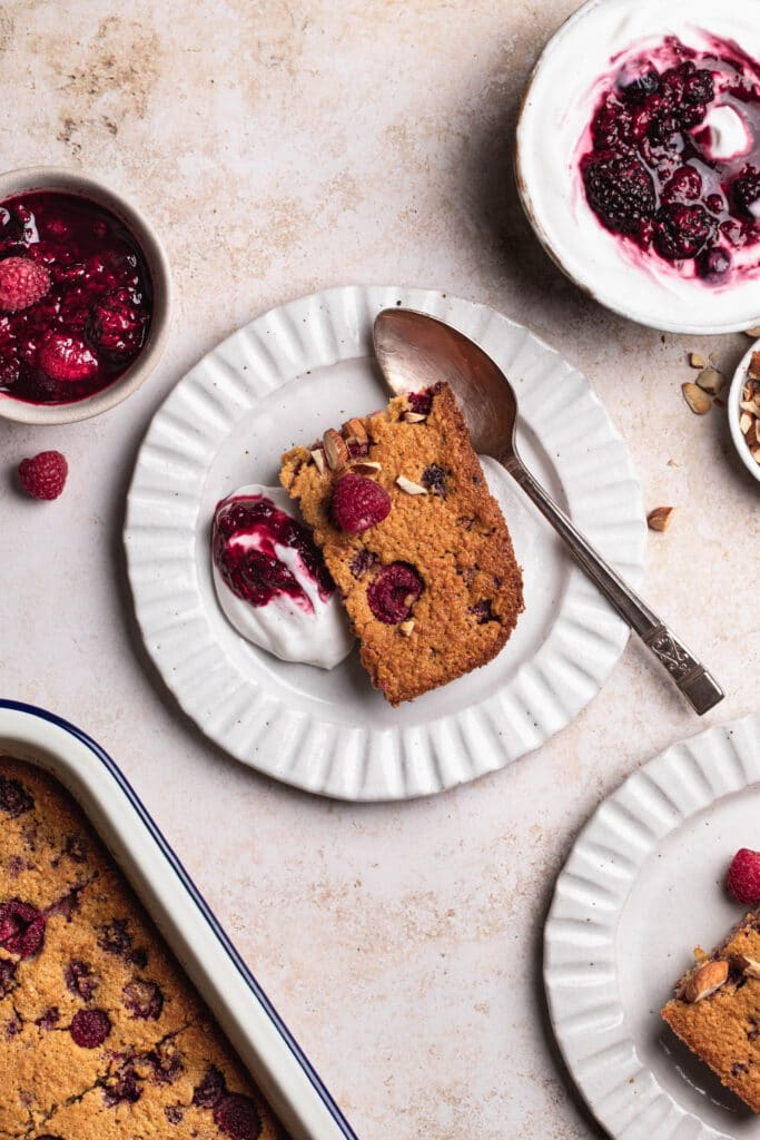 Raspberry baked oats served with yoghurt and berries.