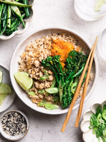 asian chicken rice bowl with kimchi, broccolini and beans