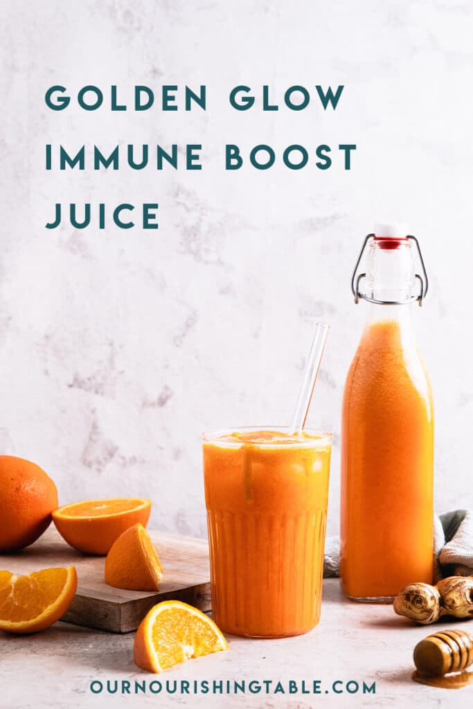 a glass and a bottle of golden glow immune boost juice, with oranges off to side.