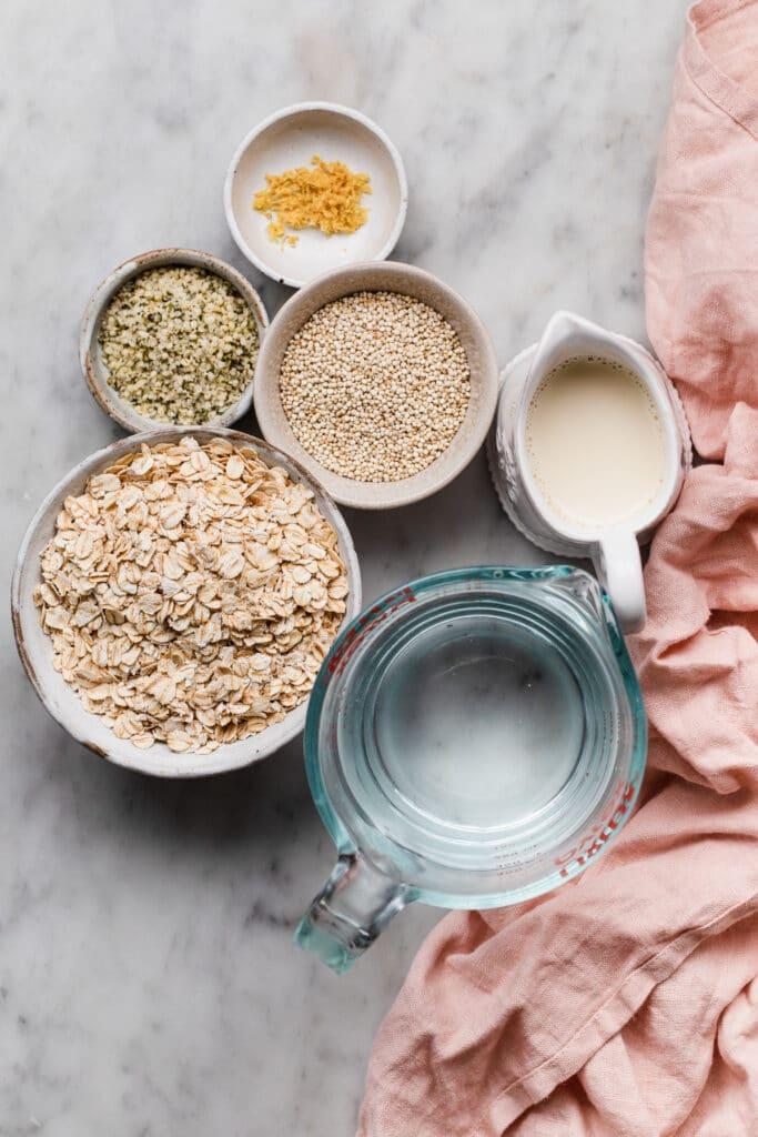 ingredients for quinoa porridge - oats, quinoa, hemp seeds, water, milk and lemon zest