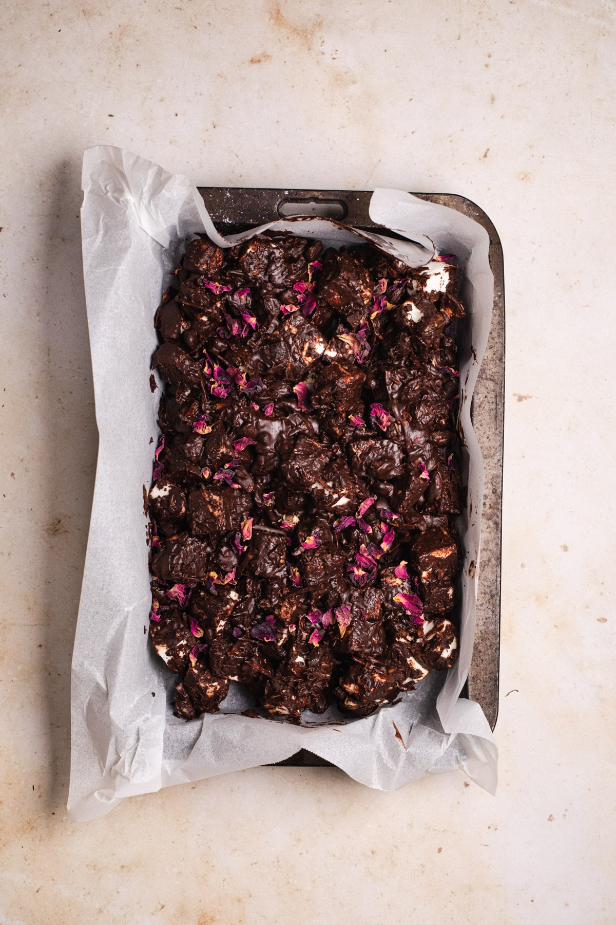 healthy rocky road topped with dried rose petals