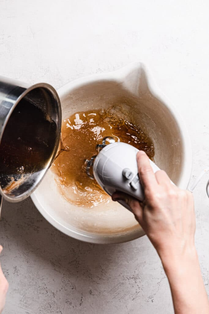 pouring honey syrup into bloomed gelatin and mixing.