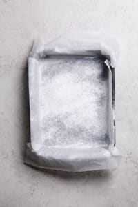 baking paper lined baking tin dusted with tapioca starch or arrowroot flour