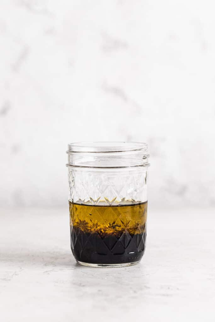 extra virgin olive oil, wholegrain mustard and balsamic vinegar in small jar