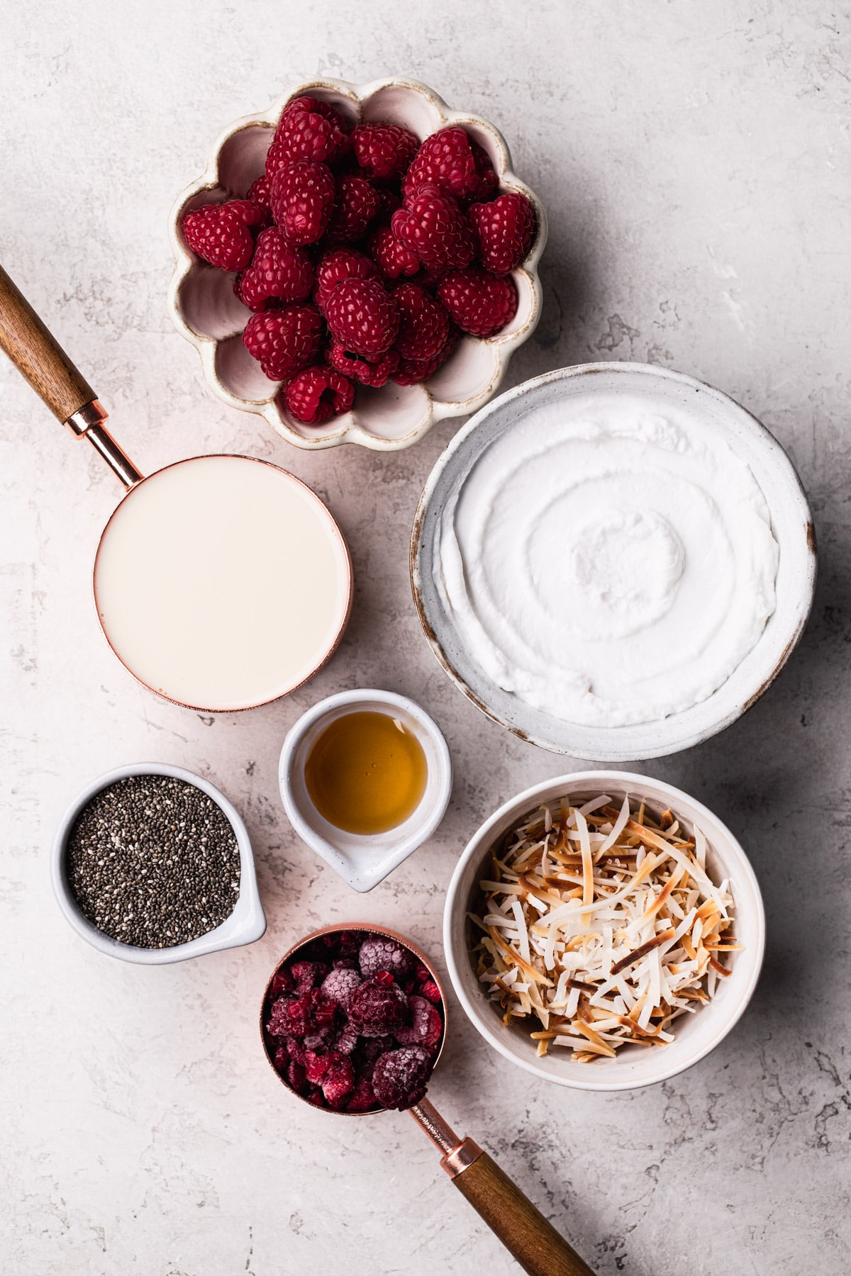 ingredients needed for chia pudding including chia seeds, plant based milk and honey