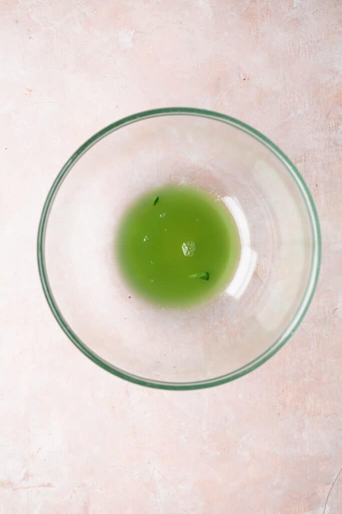 Liquid from a cucumber in a glass bowl.