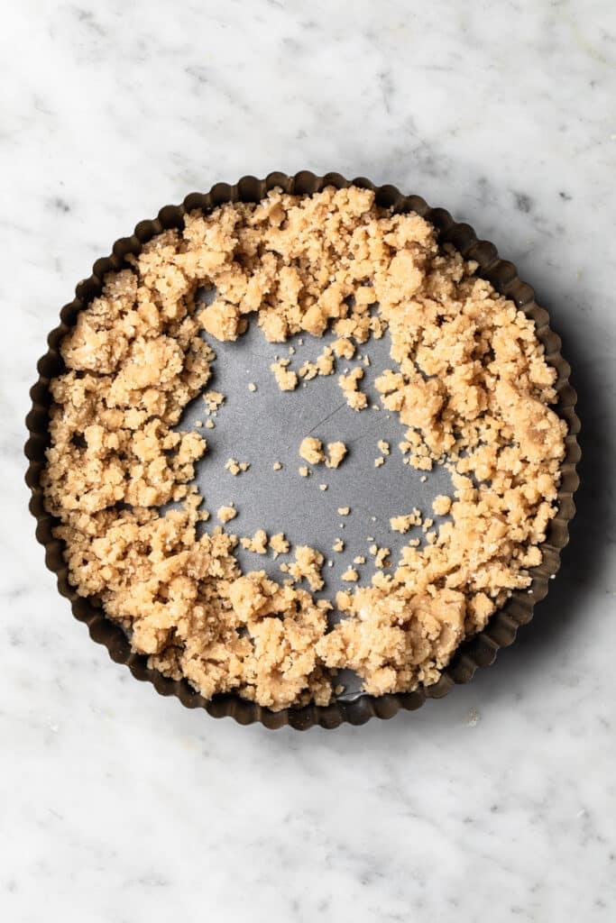 shortcrust pastry dough in base of tart tin.